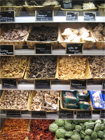 Mushrooms, artichokes and dried peppers in the produce section