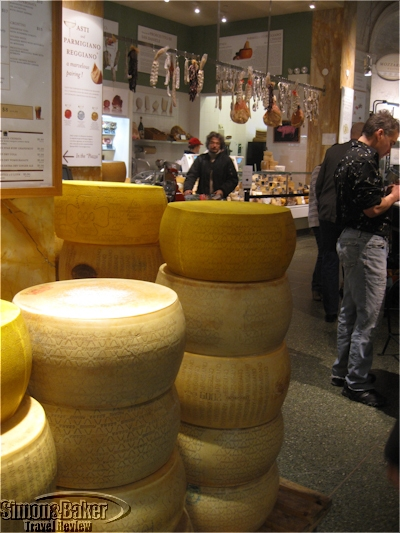 Rounds of cheese stored near the wine bar