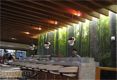 The sushi bar formed one wall of the restaurant