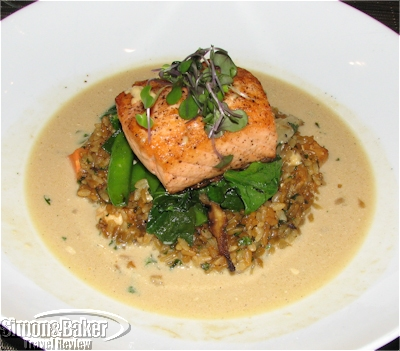 The salmon resting on its rice island in the miso soup