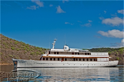 The M/Y Grace at anchor in a secluded cove of the Galapagos archipelago