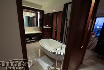 The large bathroom featured tub and shower