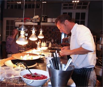 Luke Dale-Roberts preparing plates at the Test Kitchen