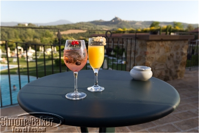 Enjoying complimentary cocktails on the outdoor patio of Adler Thermae, Tuscany