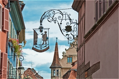 Antique wrought iron signs are still a common sight in Colmar
