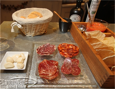 A selection of Spanish pork products with crackers and homemade tomato dip