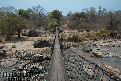 The lodge was reached via a suspension footbridge over the Mkulumadzi River