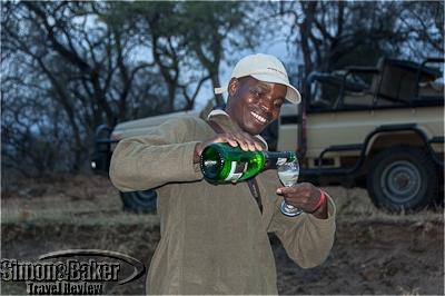 Samuel Chihana pours a sundowner drinks for us