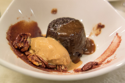 Sticky pudding with date puree, candied pecans and caramel ice cream