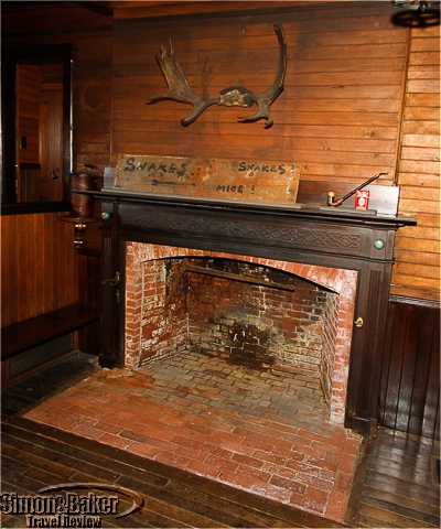The fireplace with a few original touches
