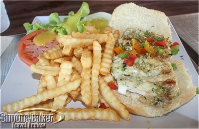 My fresh fish sandwich with fries and a side salad at Sunshine's Beach Bar & Grill