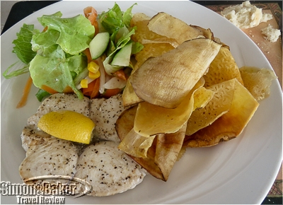 My fresh caught king fish with a side salad and Nisbet Chips at Sea Breeze Beach Bar