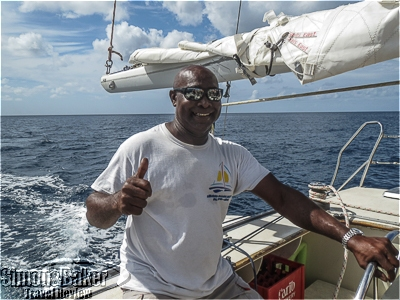 Lennox Wallace, our captain, stands at the helm.