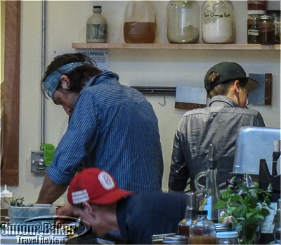 The open kitchen allows diners to watch the chef at work