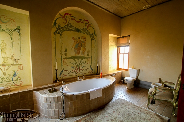 One of two spacious bathrooms with a large bathtub