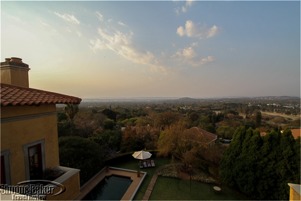 A view of my room on the left, the swimming pool and backyard in the foreground and Pretoria in the background