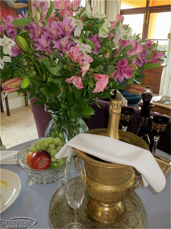 Sparkling wine and flowers on arrival