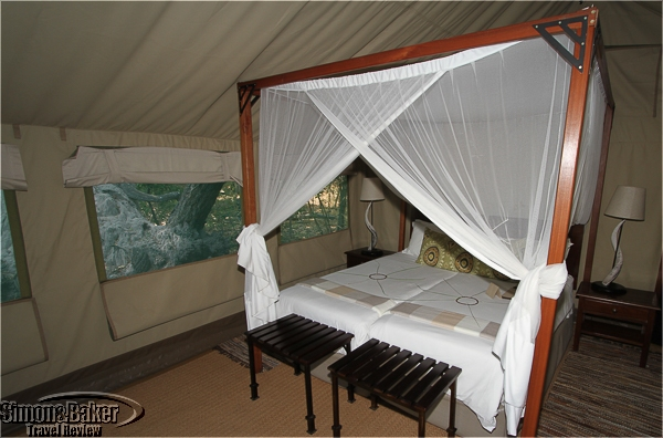 The beds has mosquito netting
