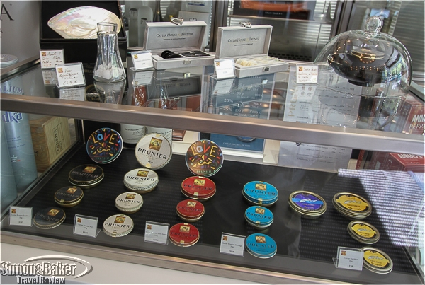 The display case shows the varieties of caviar available