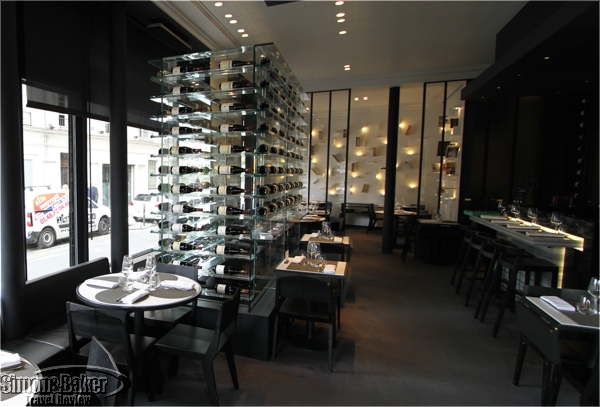 The transparent wine rack makes the space feel more open